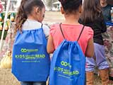 KNTR backpacks are sponsored by Bookmans Entertainment Exchange. © Denise Gary