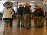 Kids Need to Read was invited to attend a special Cinco de Mayo celebration at the school. Here, some of the students participate in the dancing. © Denise Gary