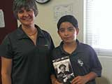 During the Dr Seuss event, a young man asked Denise if KNTR had a book about Harry Houdini. Denise surprised him in June with a fantastic book about The Great Houdini! © Denise Gary