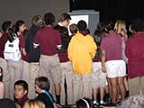 Students gather to interact with the author after the presentation. © Robert Gary
