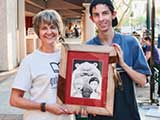 Denise and Robert had their Yosemite bear encounter artwork, drawn by author/illustrator Steven Riley, framed at a Second Friday booth. © Robert Gary
