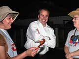 KNTR Chairman Tyson Breinholt joins the party, but isn't sure he wants to have anything to do with the crawfish. © Robert Gary