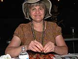 Denise enjoys more mudbugs. © Robert Gary