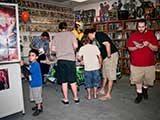Kids and adults swarmed the free comic book table. © Denise Gary