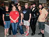 Denise, Batman, Catwoman, and Todd surround Phoenix Comicon staff, including Volunteer/Guest Director Brandy Kuschel (red shirt) and Programming Director Joe Boudrie. © Denise Gary