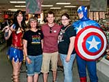 Wonder Woman and Captain America watch over Denise, Phoenix Comicon Director Matt Solberg, and Phoenix Comicon Marketing Director Jillian Stark Squires. © Denise Gary
