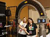 KNTR volunteers Alicia Summers and Sherrie Miller have fun under the KNTR Geek Arch. © Bruce Matsunaga