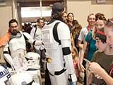 Stormtroopers and Mando Mercs help with the Star Wars Smuggler's Run and Bounty Hunt games benefiting KNTR. © Bruce Matsunaga