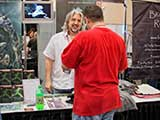 PJ is surprised by the first secret fan of <em>Devious Beings</em>. &copy; Robert Gary