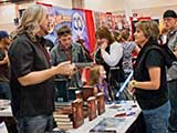 "Denise listens ""seriously"" to PJ's incredulous tale of DVD signings. © Robert Gary"