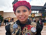 A boy decks his costume out with KNTR buttons!